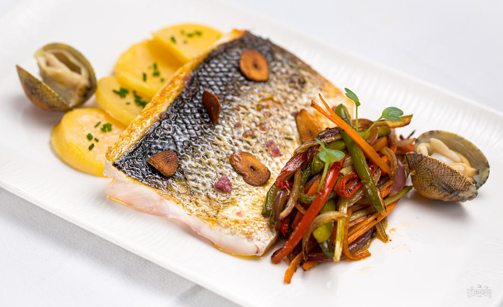 Oven-baked sea bass with vegetable stir-fry