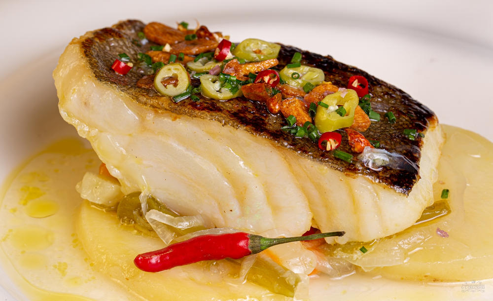 Codfish in its juice with chili